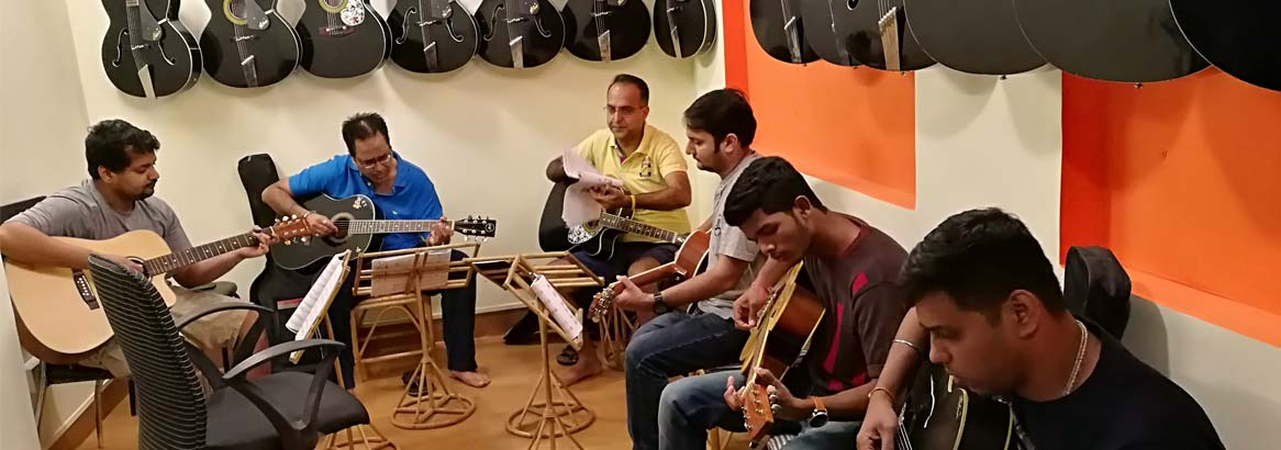 "<h3 style=""color:#fff;font-family:Georgia;  text-align: center;""><b>Welcome To <br>Kiran Roy's Guitar Studio</b></h3>"